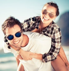 smiling couple wearing sunglasses